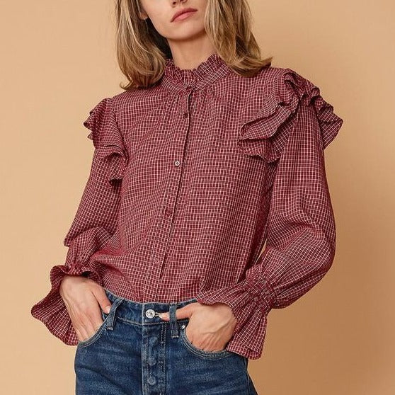 Women wearing ruffled shoulder plaid shirt