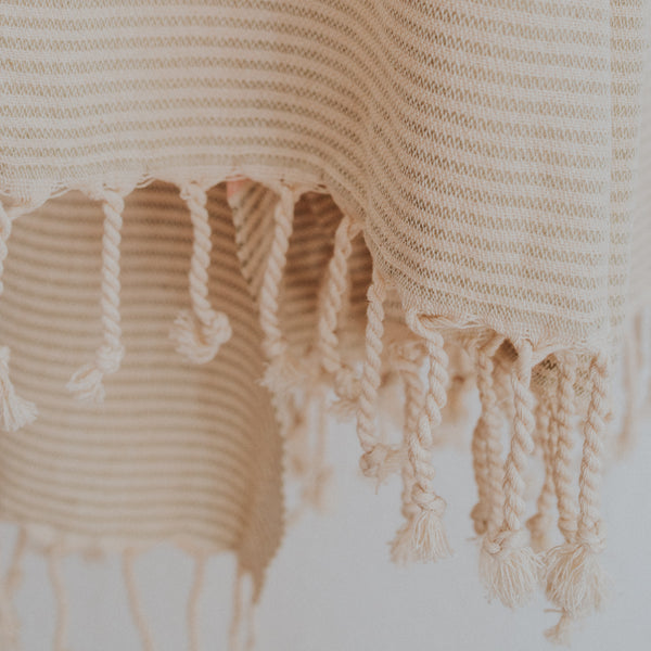 Close up of Bon Ton Studio Flora Turkish Towel in Salmon color