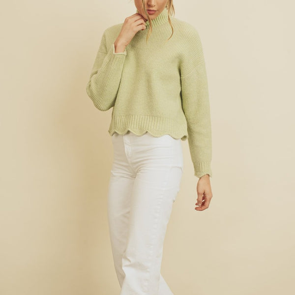 Women wearing sage green scallop hem sweater