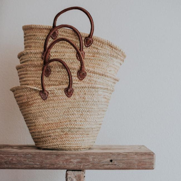 Featuring leather handles, our handwoven straw tote is the perfect size carryall for your market haul, weekend away or as an everyday purse.