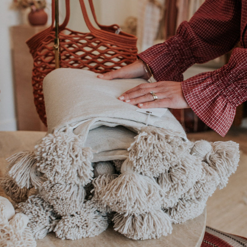 Styled-Home-Decor-Natural-Hand-Woven-Pom-Pom-Blanket-Bon-Ton-Studio