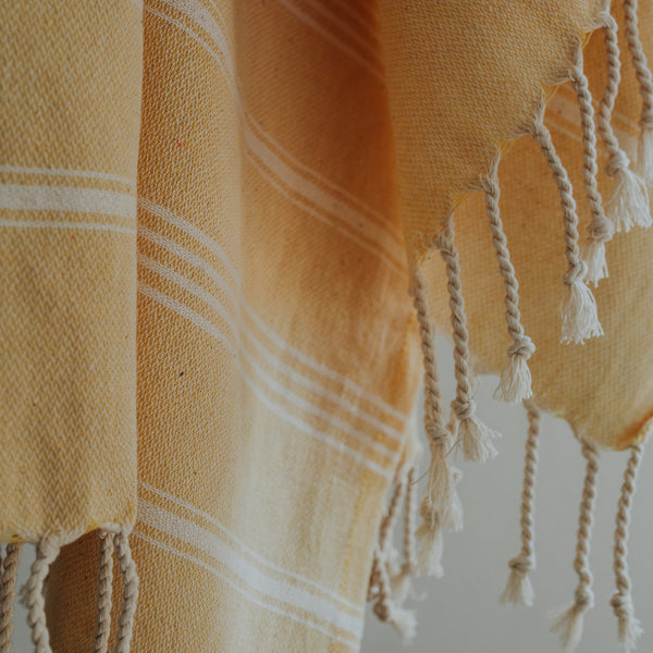Close up of Bon Ton Studio Thea Turkish Towel in Sunburst color