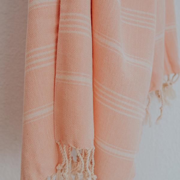 Close up of Bon Ton Studio Thea Turkish Towel in Salmon color