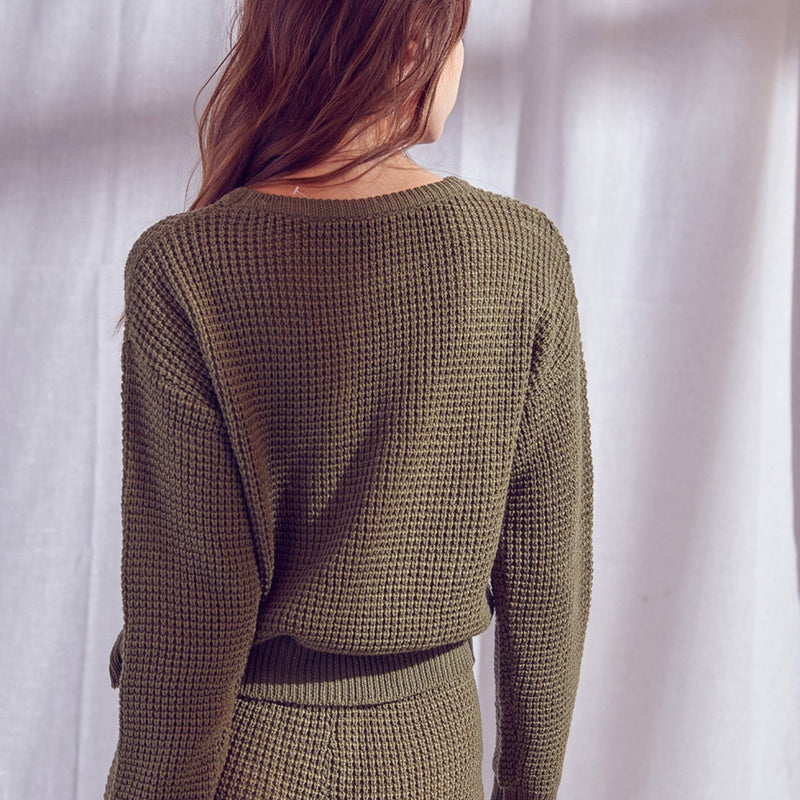 Women wearing a thermal knit olive green pullover