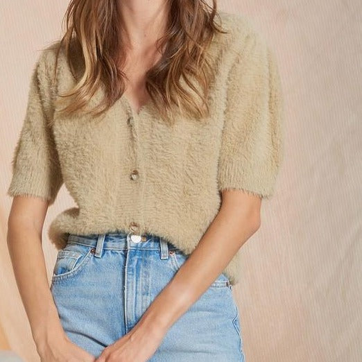 Women wearing camel fluffy puff knit button down sweater