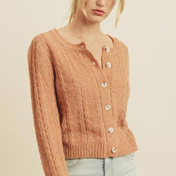 Women wearing button down knit cardigan