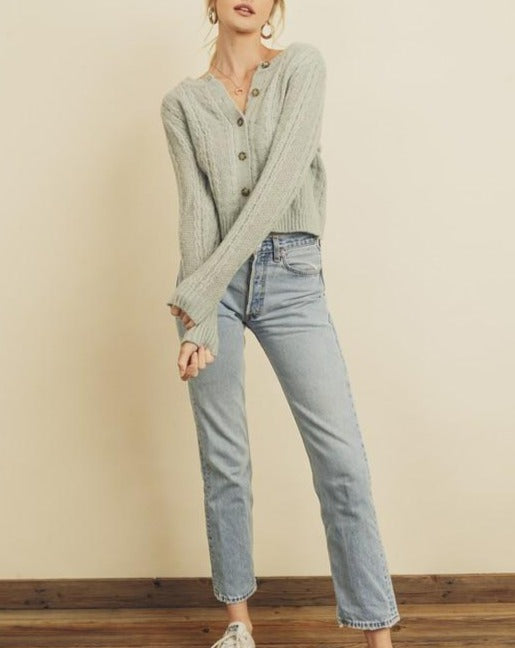 Women wearing heather grey knit button down cardigan