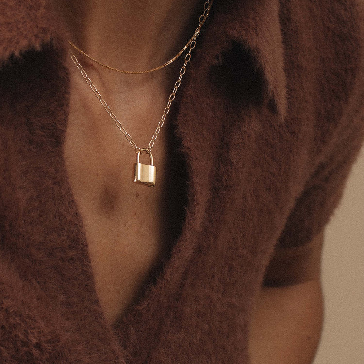 Women wearing gold filled box chain necklace