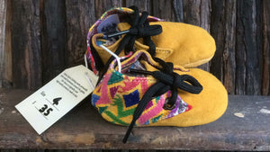 Mustard suede with aztec coloured shapes
