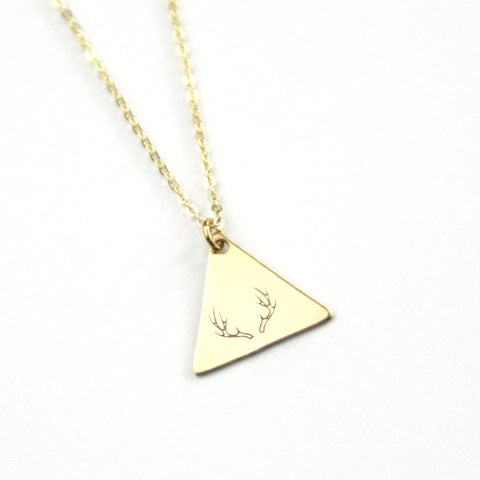 Brass stamped antler symbol on a gold plated 18 inch chain