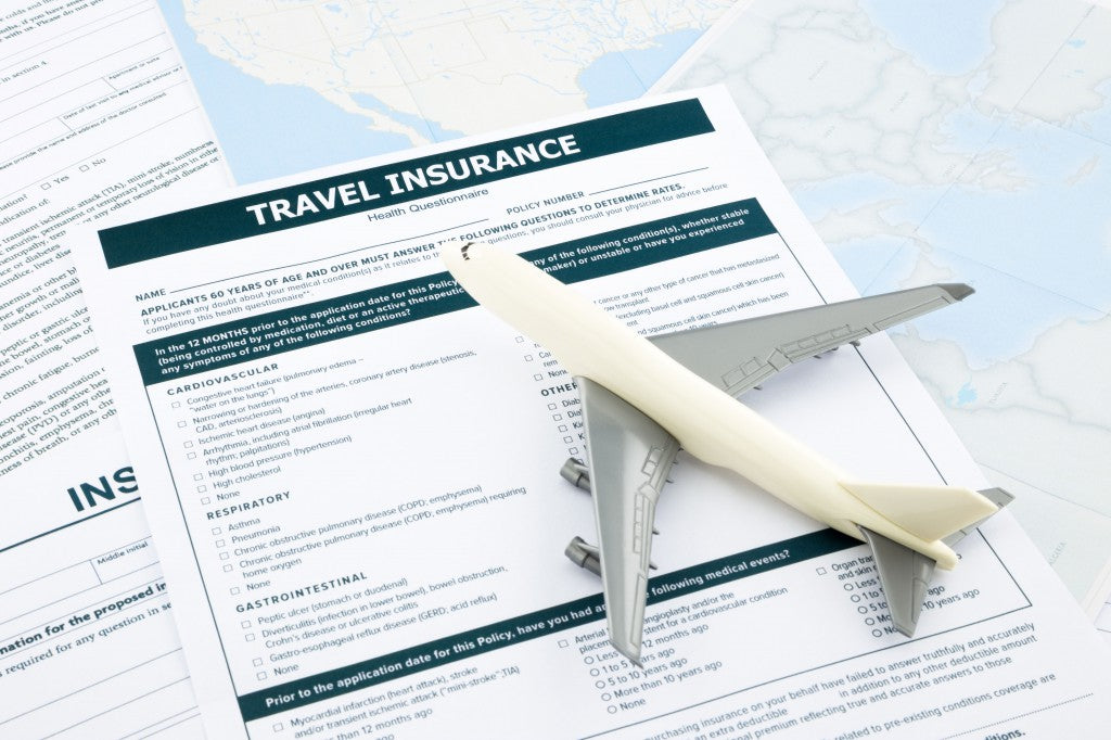 bigstock-Travel-Insurance-Form-And--Pl-64476427