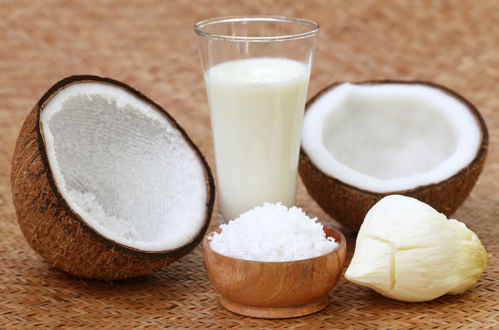 bigstock-Fresh-Coconut-With-Milk-In-A-G-75839626