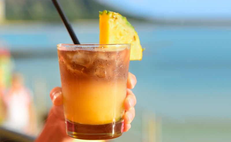 bigstock-Mai-Tai-hawaiian-drink-on-beac-93773648