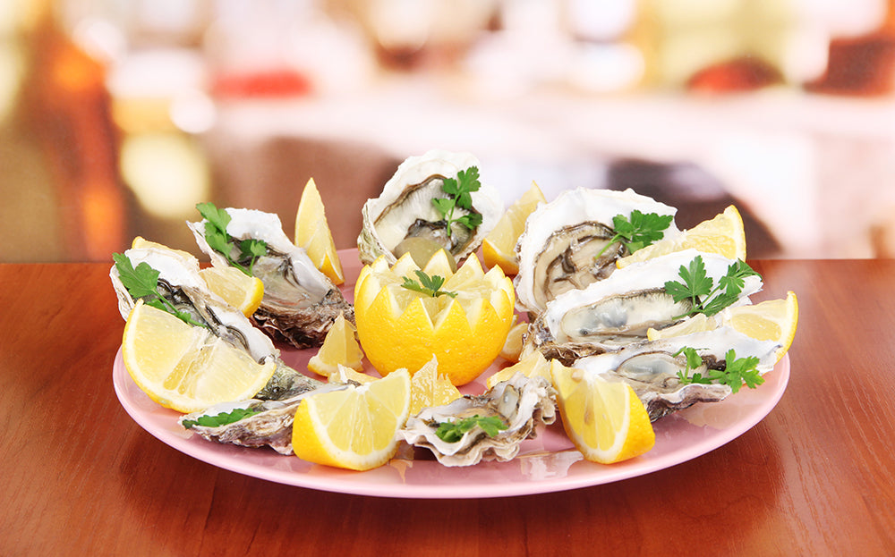 Oysters on table in cafe