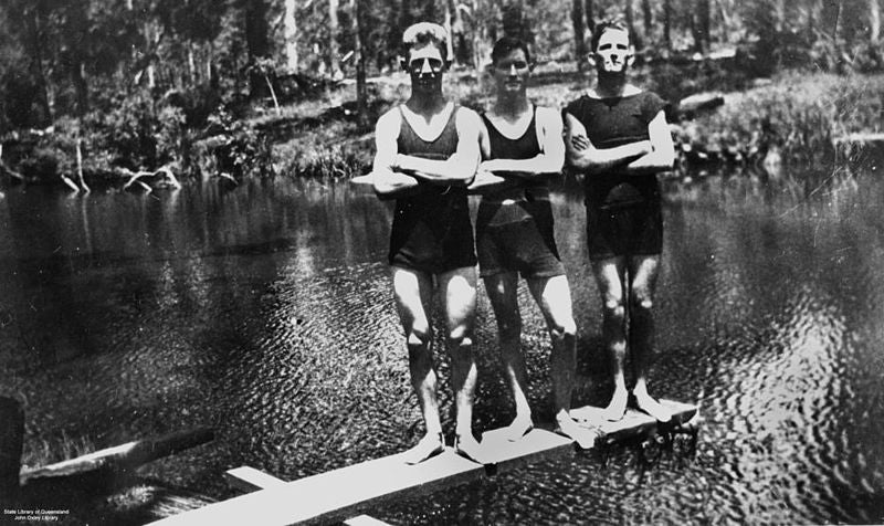 800px-StateLibQld_2_177815_Three_men_on_a_diving_board_over_a_swimming_hole,_1920-1930