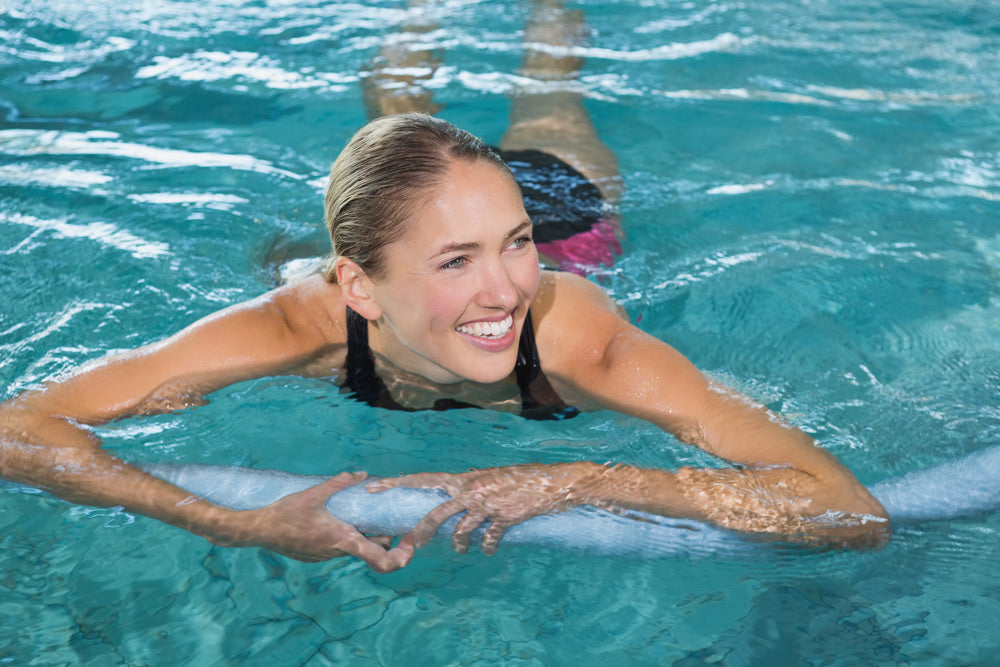 bigstock-Fit-blonde-swimming-with-foam--68118760