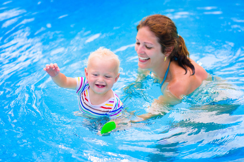bigstock-Mother-And-Baby-In-Swiming-Poo-81203321