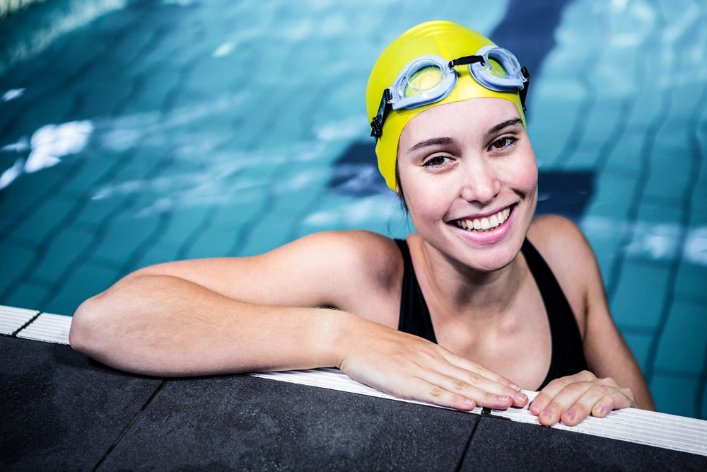 bigstock-Smiling-swimmer-woman-lean-on--116427761