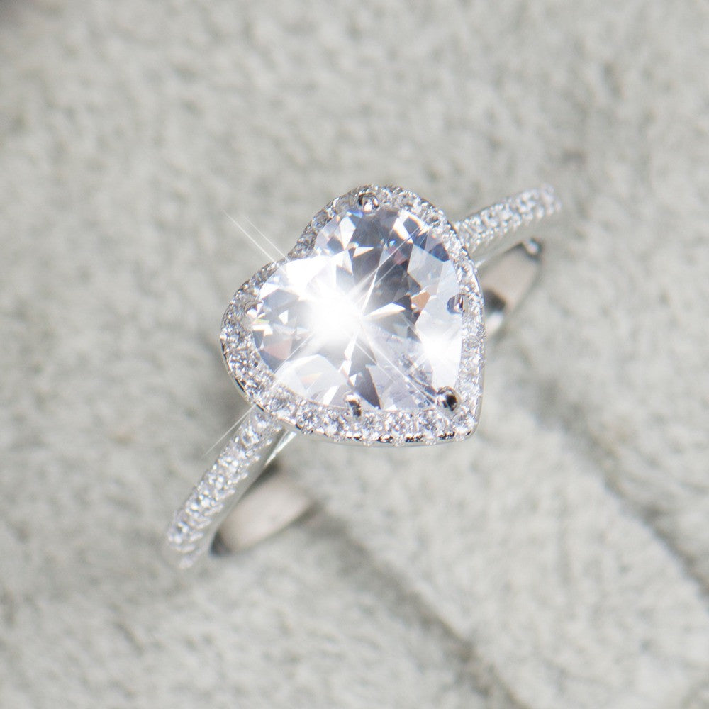 white heart gold set in bezel shape engagement ring diamond solitaire