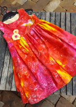 vibrant reds and yellow in this fun sun dress