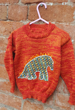 orange dinosaur jumper