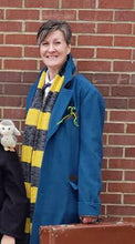 happy customer in a newt scarf