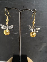 silver winged golden snitch earrings