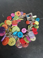 button filled cluster charm bracelet