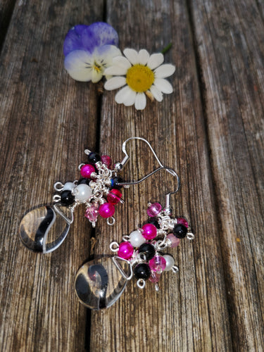 Hot pink cascade earrings with 925 silver earwires and clear swirled pear drops.