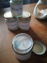 white tea candle with glitter