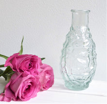 Clear glass bottle vases from Grand Illusions