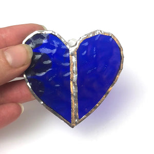 Deep Blue Stained Glass Heart, Held up by finger tips to show colour