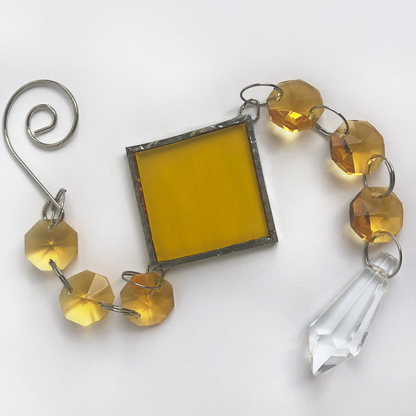 Overhead view of yellow crystal sunshine rainbow maker