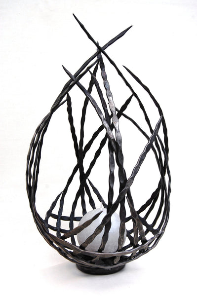 hand forged metal candle holder/sculpture by Aaron Petersen