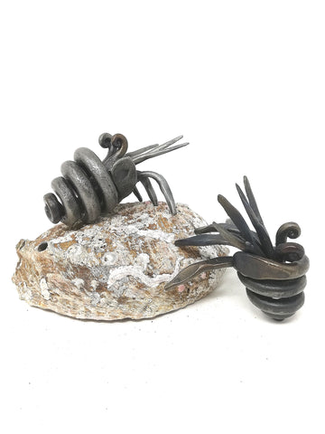 Little hand forged, mild steel, hermit crab sculpture.