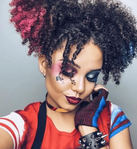 Halloween hairstyles for afro hair: Afro Pigtails: Harley Quinn with afro hair