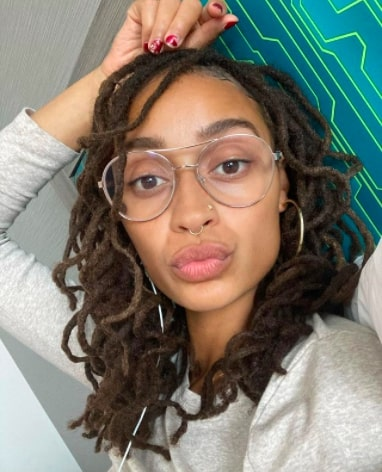 Afrocenchix 7 Methods to Start Locs You Should Know About: Pretty Black woman wearing glasses with Interlocked locs from IG @nadiakamaria