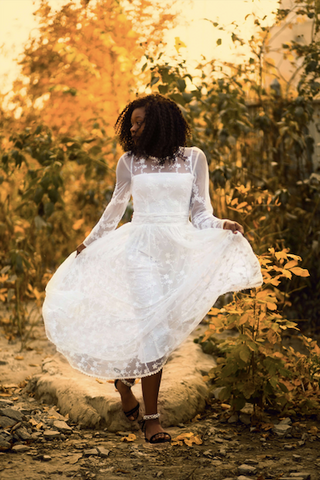 Afrocenchix Wedding Hairstyles for Natural Hair Pexels black woman dancing in wedding dress in nature