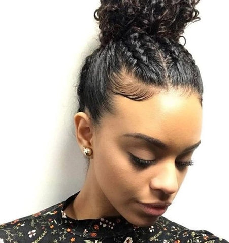 Afrocenchix article Braid Hairstyles: Young black woman looking down with a braided high bun