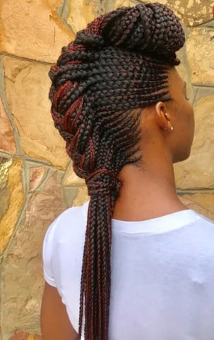 Afrocenchix article Braid Hairstyles: Back view of a black woman with a chunky cornrowed mohawk