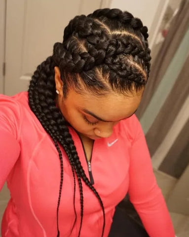 Afrocenchix article Braid Hairstyles: Black woman with her head down showing off herCriss-cross braids