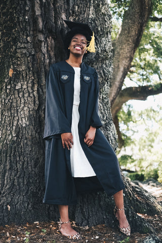 Afrocenchix graduation Hairstyles for natural hair: black woman wearing a graduation cap standing under a tree
