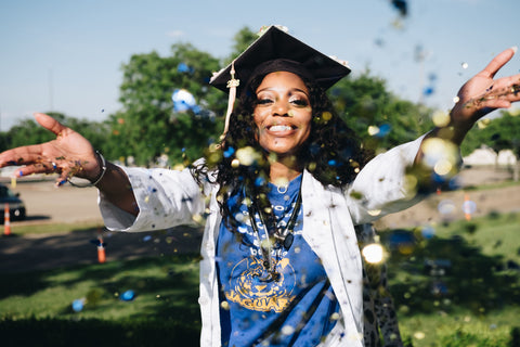 Afrocenchix graduation Hairstyles for natural hair: happy black woman throwing confetti
