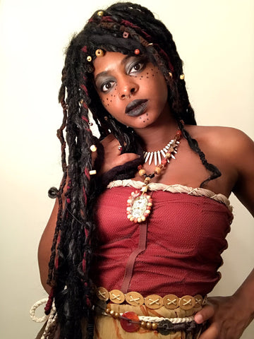 Beautiful Black Woman with Locs & Seashells hairstyle inspired by Calypso From Pirates of the Caribbean - TheDeLaDoll - Halloween Hairstyles Afrocenchix Article
