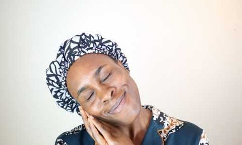 How to do a puff on natural hair tutorial pretty young black woman smiling with Afrocenchix satin lined bonnet