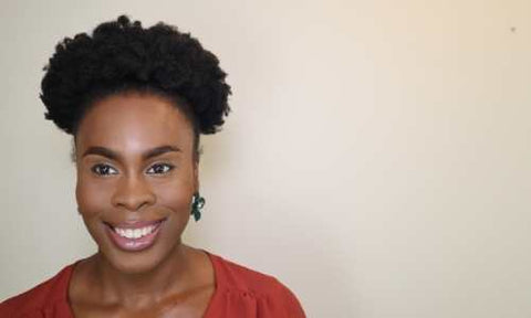 How to do a puff on natural hair tutorial pretty young black woman smiling with classic puff hairstyle