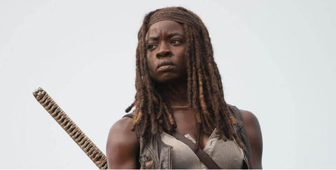 Halloween hairstyles for black hair: Locs and headband: Michonne from The Walking Dead