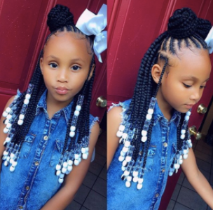 back to school hairstyles: young black girl with braids, bow and beads