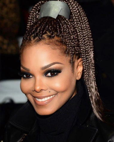 Janet Jackson with single box braids in a high ponytail