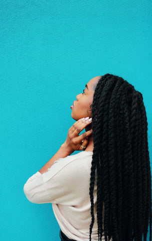 Black of a black woman's head with Senegalese Twists - Afrocenchix transitional hairstyles inspo article